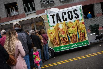 During the 2015 Wide Open Bluegrass Festival the rains seem to damper all activities outside, but subsiding briefly on Oct. 3, crowds enjoyed the street foods and food trucks that had previously not seen a draw from the crowds.( JOHN WEST/WRAL contributor)