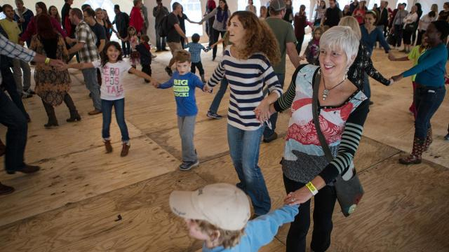 People enjoy a square dancing session in the dance tent during the 2015 World Of Bluegrass Festival, Oct. 3, 2015. ( JOHN WEST/WRAL contributor)
