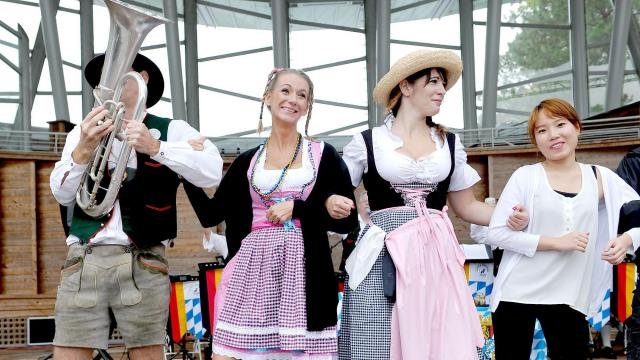 Participants dance with the Little German Band at the Triangle Oktoberfest, which took place at Koka Booth Amphitheatre in Cary on Sunday, October 4, 2015. Photo by Christine Adamczyk.