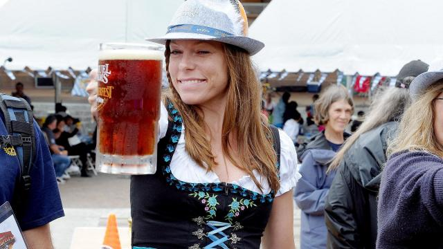 The stein hoist was a popular competition at the Triangle Oktoberfest, which was held at Koka Booth Amphitheatre in Cary on Sunday, October 4, 2015. Photo by Chris Adamczyk.