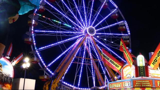 Rides light up the midway at the North Carolina State Fair on October 21, 2015. (Photo by: Jerome Carpenter/WRAL Contributor)
