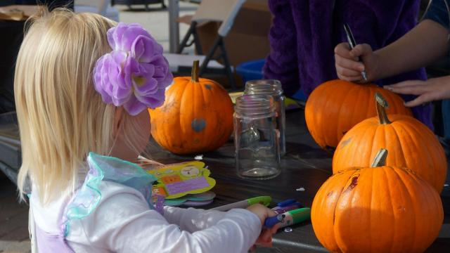 Children also decorated pumpkin at Midtown Farmers Market on Saturday, Oct. 31, 2015.