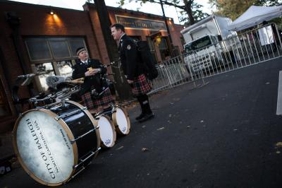 Timothy Hinson, pictured left and Seth Sethwell, bagpipe players and members of the Wake and District Public Safety Pipes and Drums, wait for fellow band members in front of the Tir Na nOg Irish Pub on Nov. 22, 2015, during the pubs farewell party. ( JOHN WEST/WRAL contributor)