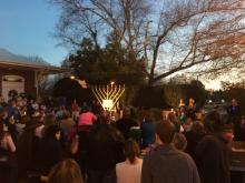 A menorah lighting in downtown Apex on Sunday evening.