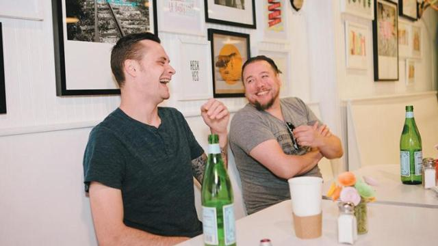 Greg Gettles of Piedmont and Josh Munchel of Counting House chat with Elizabeth Shestak at Parker and Otis Thursday, July 30, 2015. (Briana Brough/Durham Magazine)