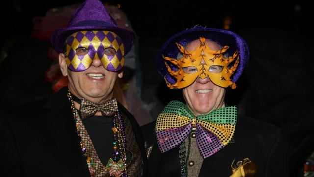 Locals dressed in their best Carnival costumes celebrate New Orleans style at Durham Mardi Gras in downtown Durham N.C. on February 9, 2016. The evening staarted with a parade crossing town to live music, food, and spirts. (Chris Baird / WRAL Contributor).
