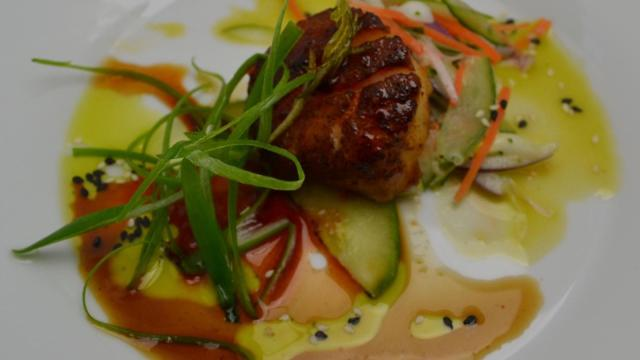 Course 1: Porcini Smoked Paprika Seared Scallop, Grilled Cucumbers, Wasabi Ran-Lew Dairy Buttermilk Ranch Slaw, Basil Lime Cloister Ghost Pepper Honey Vinaigrette Ran-Lew Dairy Milk Company, LLC Cloister Honey  ‪(Competition Dining)