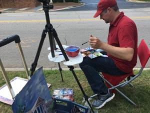 It was an unusual - but wonderful - sight to see artists painting alongside downtown Cary streets.