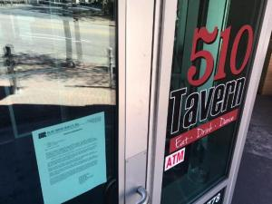 A notice for failure to pay rent was posted in the window of 510 Tavern on Oct. 26, 2016. The business is closed. (Image from Patrick Madigan)