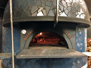 Pizza La Stella uses two of these Italian crafted wood-burning ovens.
