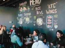 The chalkboard menu lists the five items available each day.   Photo by Briana Brough