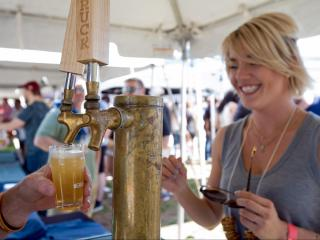 An employee from Brown Truck Brewery out of High Point pours a sample of their gold-medal-winning lager on Saturday at the World Beer Festival in Raleigh.