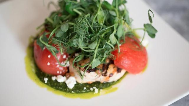 """""""Lunch is mostly sandwiches and entrée salads,"""" Brandon says, """"but I'm doing ones that are off the beaten path."""" Enter the chicken salad Genovese (above), utilizing Boxcar Creamery feta, confit roma tomatoes and """"this incredible local basil."""" Photo courtesy The Carolina Inn"""