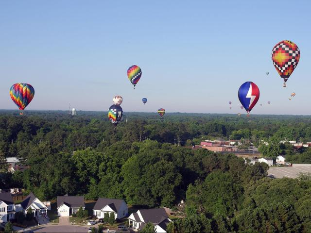 Dozens of balloon teams competed over Fleming Loop Park in Fuquay-Varina at the 2017 WRAL Freedom Balloon Festival.<br/>Photographer: Jodi Leese Glusco