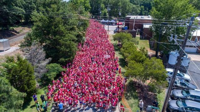 A popular local run club and 1,363 participants beat a Guinness world record on Saturday using their legs and several hundred pairs of flip flops.