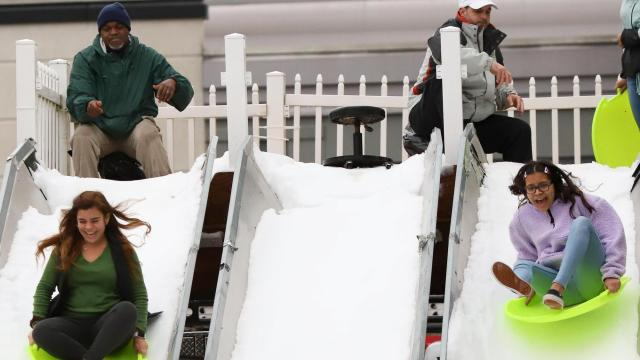 Attendees enjoy sledding down the snow slopes. The Annual Christmas Tree Lighting Celebration was held in the Commons of North Hills in Raleigh, NC on November 23, 2019 (Jerome Carpenter/WRAL Contributor)