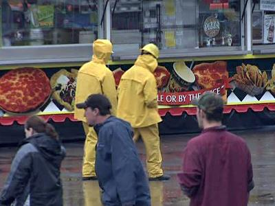 Vendors at the North Carolina State Fair wear rain jackets to protect themselves from downpours on Oct. 14, 2009.