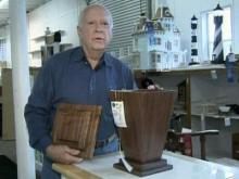 Woodworker carves images of death