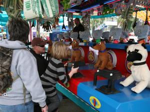 A family prepares to play at the N.C. State Fair on Sunday, Oct. 25, 2009.