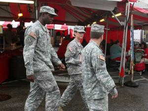 Soldiers walk through the midway at the North Carolina State Fair on Oct. 19, 2011.