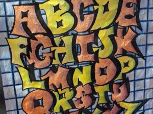A student art entry stylizes the alphabet at the 2012 NC State Fair.