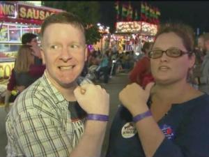 Donald Robbins and Sara White hit the rides together at the NC State Fair.