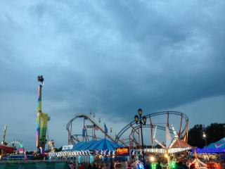 The heavy cloud cover made an interesting backdrop to the lights and activity of the rides.