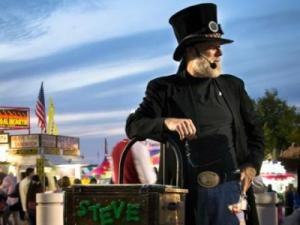 Magician Steve Trash has been performing disappearing acts on the Midway for the last four years. (Photo by Delmis Rivera)