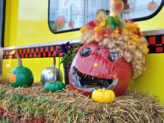 Quirky carved pumpkins outside the Wisconsin cheese truck at the NC State Fair.