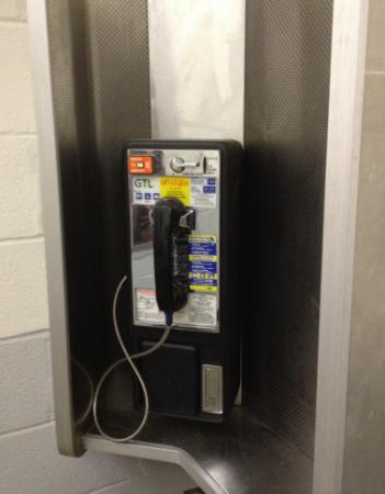 There are pay phones outside the Village of Yesteryear and inside the Jim Graham Building.