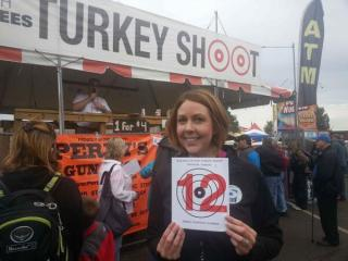 WRAL Out and About Editor Kathy Hanrahan proudly displays her turkey shoot target.