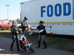 A family donates food on Oct. 24, 2013.