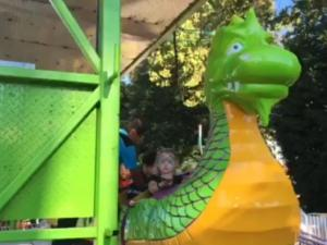 A family got a fright Thursday when their 3-year-old slid down in the seat of the Dragon Wagon.