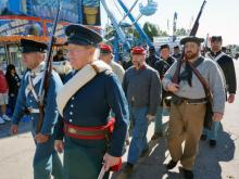 A parade highlighting the unique military uniforms of the past kicked off Military Appreciation Day festivities at the N.C. State Fair on Oct. 22, 2014.