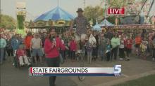 IMAGE: Roberto the Magnificent shows off unicycle and juggling skills at State Fair