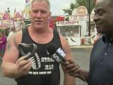 Strong man amazes with muscles at state fair
