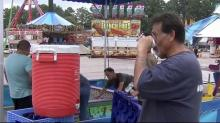 IMAGE: Record-breaking heat makes for sweaty NC State Fair set-up