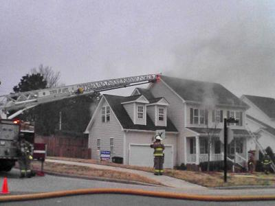 Fire crews were battling a blaze at a home on Maubrey Court in Apex early Saturday afternoon. (Photo by Stacey Nance)