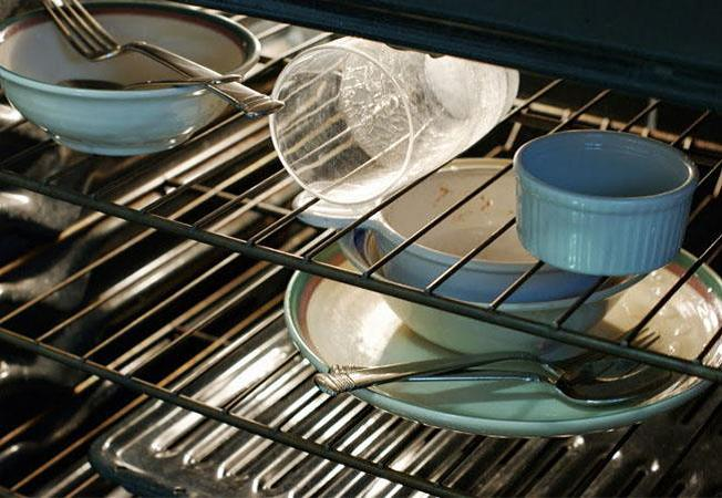 As long as the party doesn't require baking, the oven is a great place to hide away dirty dishes once the dishwasher gets full.