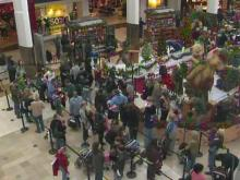 Last-minute shoppers crowded into Triangle Town Center Mall on Christmas Eve.