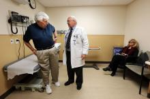 Cardiologist Brent Muhlestein, right, of Intermountain Medical Center Heart Institute, talks with Jay Niederhauser in Murray on Tuesday, April 5, 2016. Niederhauser has lost 25 pounds. They discussed healthy living and loss of dangerous weight. At right is Jay's wife Sandy. (Deseret Photo)