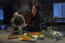 Vegan chef Molly Aubuchon pours a brine over green beans that she decided to include last minute in her vegan sushi. The beans will sit a few hours before being rolled with other ingredients into the maki rolls by Aubuchon and her children for dinner Monday, Feb. 8, 2016 in her Kent, Ohio, home. (Deseret Photo)