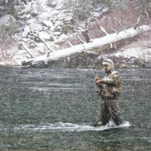 Spencer Durrant fishes for trout in the Green River during a winter storm. (Deseret Photo)