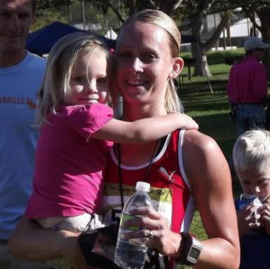 Arianne Brown with her youngest daughter after completing a race. (Deseret Photo)