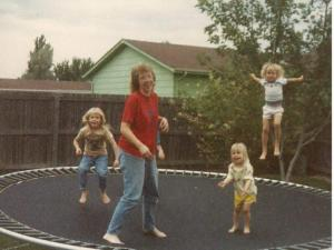 Arianne Brown, right, jumps with her sisters on her childhood trampoline. (Deseret Photo)