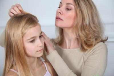 It's not just children who go back to school in the fall; they're often accompanied by head lice, the tiny parasite that bedevils many families with young children. Here are strategies to help lice-proof your household. (Deseret Photo)