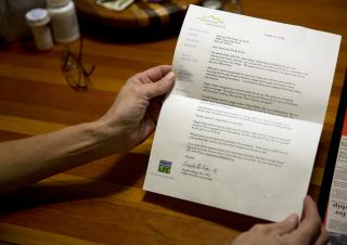 Lillie Kaster reads a letter from Intermountain Donor Services on Thursday, Nov. 3, 2016, at her home in Buhl. The letter details information about the recipients of her son's organs. According to Kaster, Roger Vulgamore's heart went to a married mother, his right kidney went to a single mother of five children, his left kidney and pancreas went to a young man working on a family ranch, his liver went to a single father of one and his lungs went to a young man that is engaged to be married. (Deseret Photo)