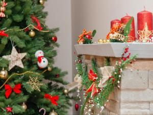 Your house may be perfectly child-proofed for the rest of the year, but the holidays bring new threats to your children's safety. Glitter, snow globes, and Christmas trees are among common holiday hazards. (Deseret Photo)
