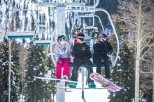 People ride up the chairlift at Eagle Point. (Deseret Photo)