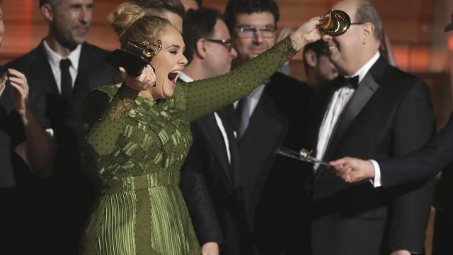 Adele accepts the award for album of the year at the 59th annual Grammy Awards on Feb. 12, 2017, in Los Angeles. Adele says she gets some of her sparkle from an infusion of vitamins delivered through an IV. (Deseret Photo)
